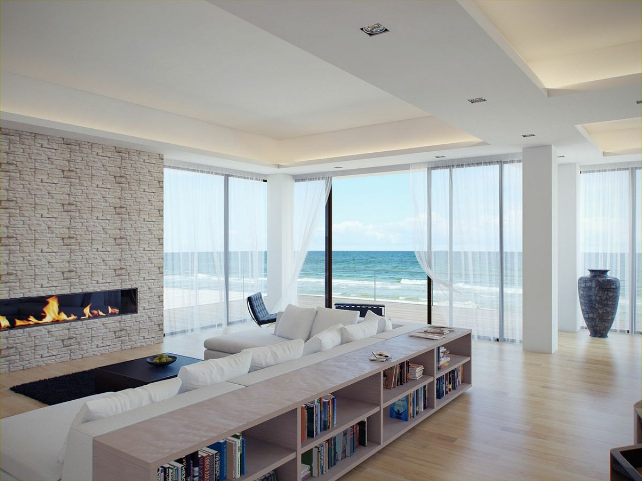 great-beach-view-white-themed-living-room-with-natural-stone-fireplace-55efe2e0765e5